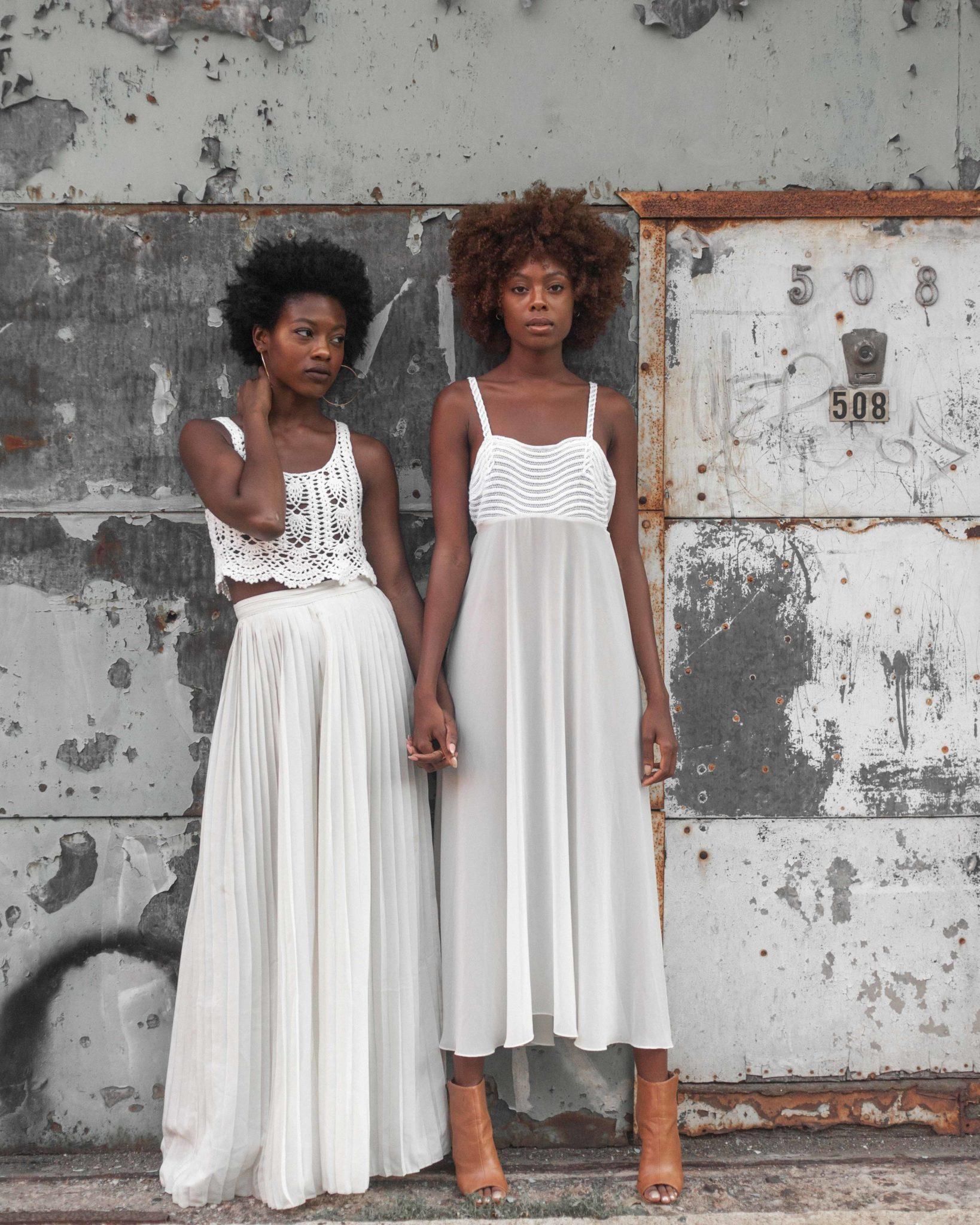Black Female Models Hold Hands